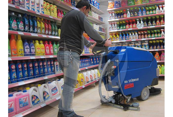 cleaning hypermarket with battery scrubber