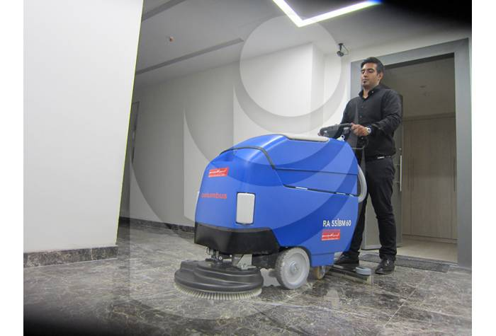 cleaning building with scrubber