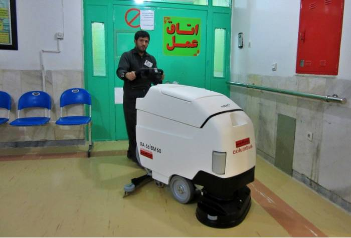 wash hospital floor with anti bacterial scrubber
