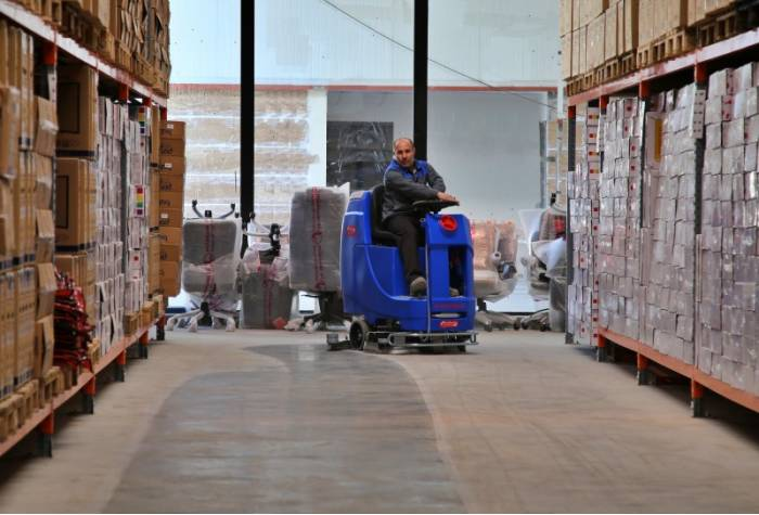 warehouse cleaning with ride on scrubber