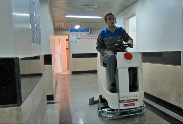 disinfect and cleaning hospital with ride on scrubber
