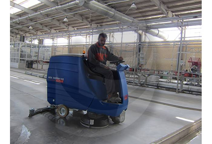 cleaning floor factory with scrubbers