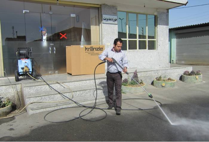 Use industrial pressure washer to wash floor surfaces