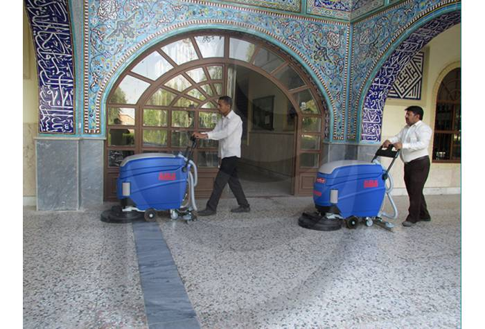 cleaning campus with battery Scrubber