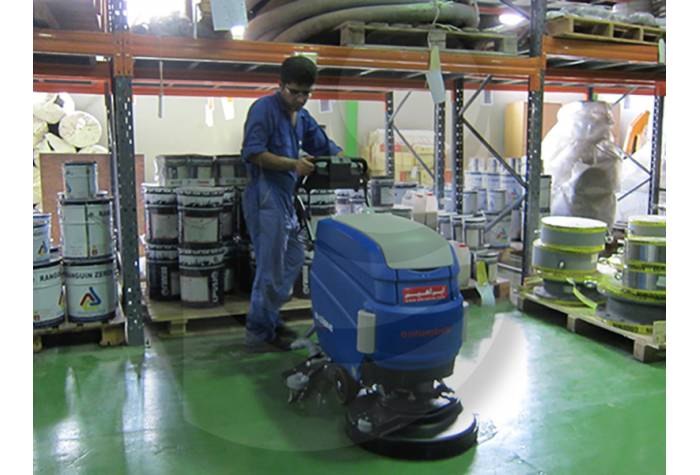 cleaning warehouse with battery Scrubber