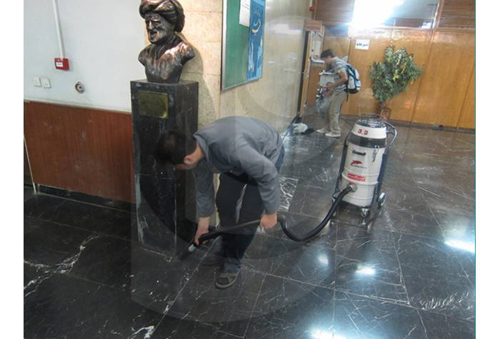cleaning  the surfaces in universities by vacuum cleraner