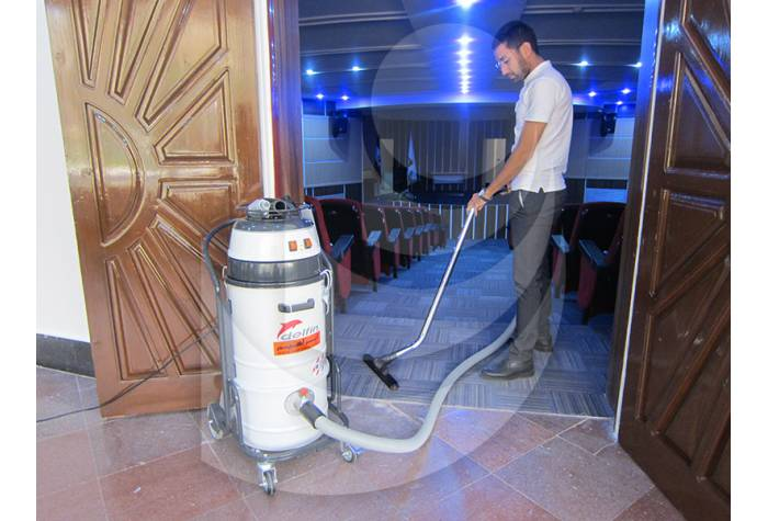 cleaning conference hall  by vacuum cleaner