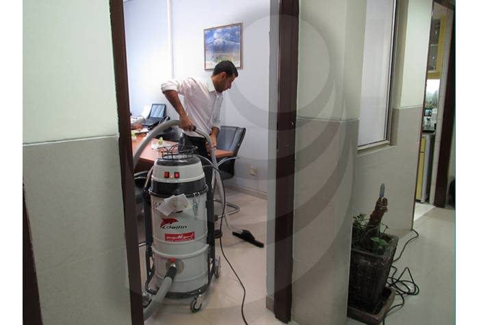using vacuum cleaner  for  office cleaning