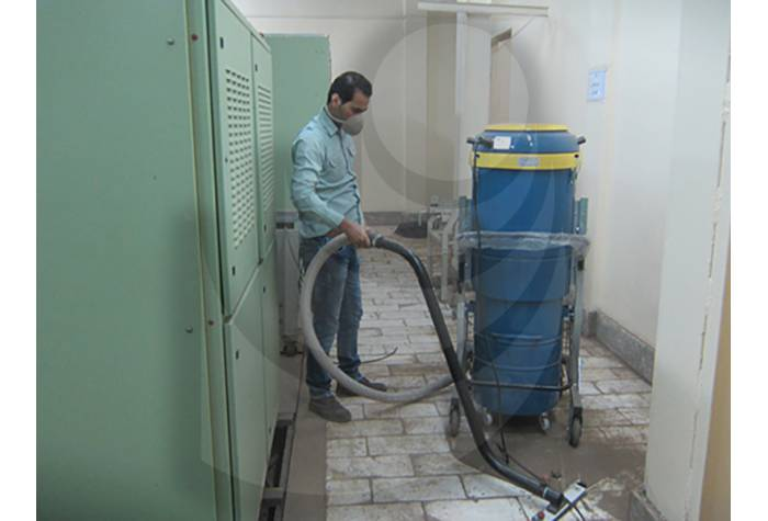using vacuum cleaner for cleaning dirt places  in industries