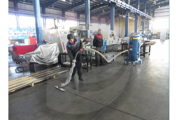 cleaning industrial shed using vacuum cleaner