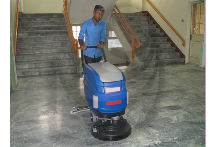 Cleaning halls and corridors in offices with scrubber